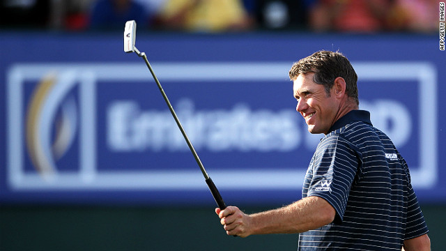 Lee Westwood has much to smile about after grabbing the lead at the Dubai Desert Classic on Saturday