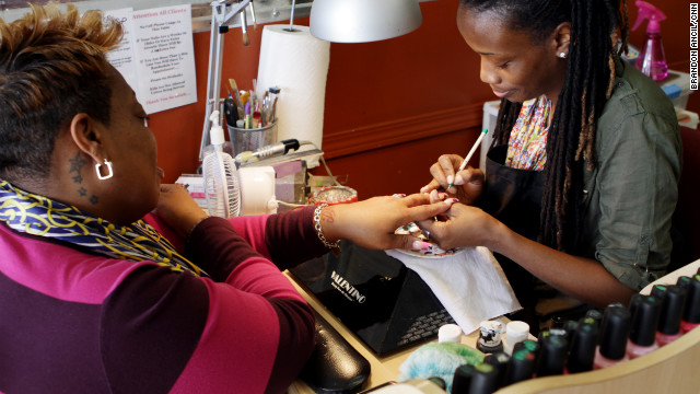 "Tashina ""Poochie"" Green says she creates works of art on her customers' nails."