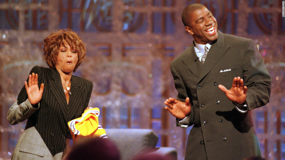 "Basketball legend Magic Johnson and Houston dance during the taping of the 1998 premier of Johnson's television show, ""The Magic Hour,"" in Los Angeles."