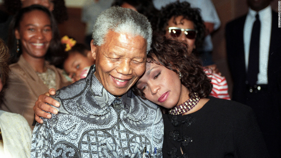 South African President Nelson Mandela hugs Houston in November 1994.