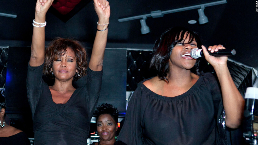 Houston and singer Kelly Price share the stage at the Kelly Price & Friends Unplugged: For The Love Of R&B Grammy party on Thursday, February 9, in Hollywood.