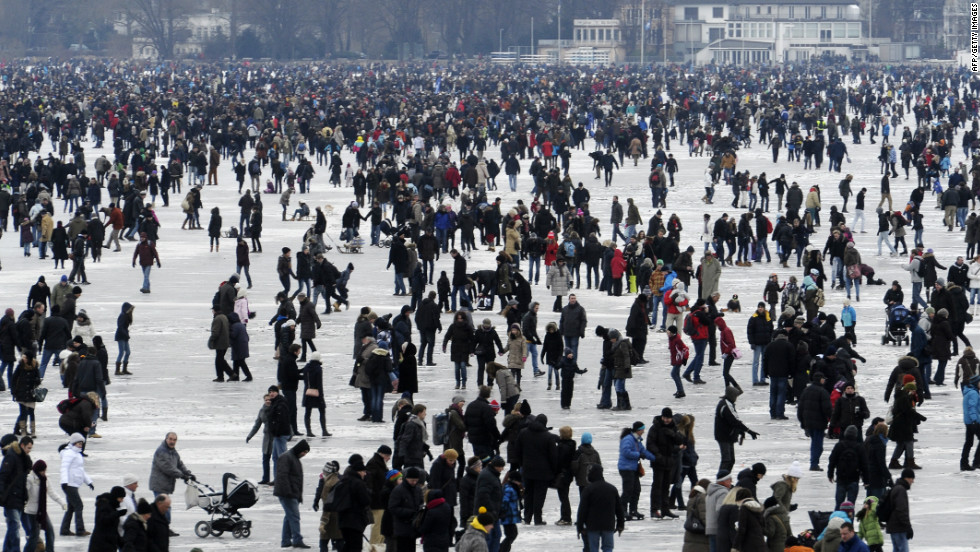 People walk on the frozen Aussenalster river during the 'Alstervergnuegen' on February 11, 2012 in Hamburg, Germany. The very popular annual city festival 'Alstervergnuegen' takes place around the Alster lake in Hamburg.