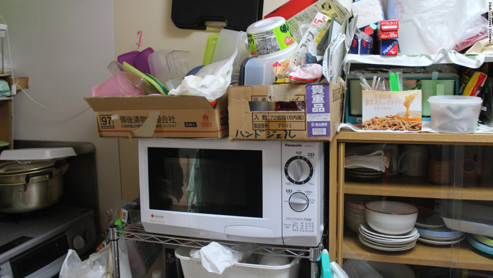"Many survivors await news of permanent housing. Mitsuyuki Wakamatsu, 65, says the cramped kitchen in his temporary shelter is a toy kitchen. ""you can't really do anything in here,"" he said."