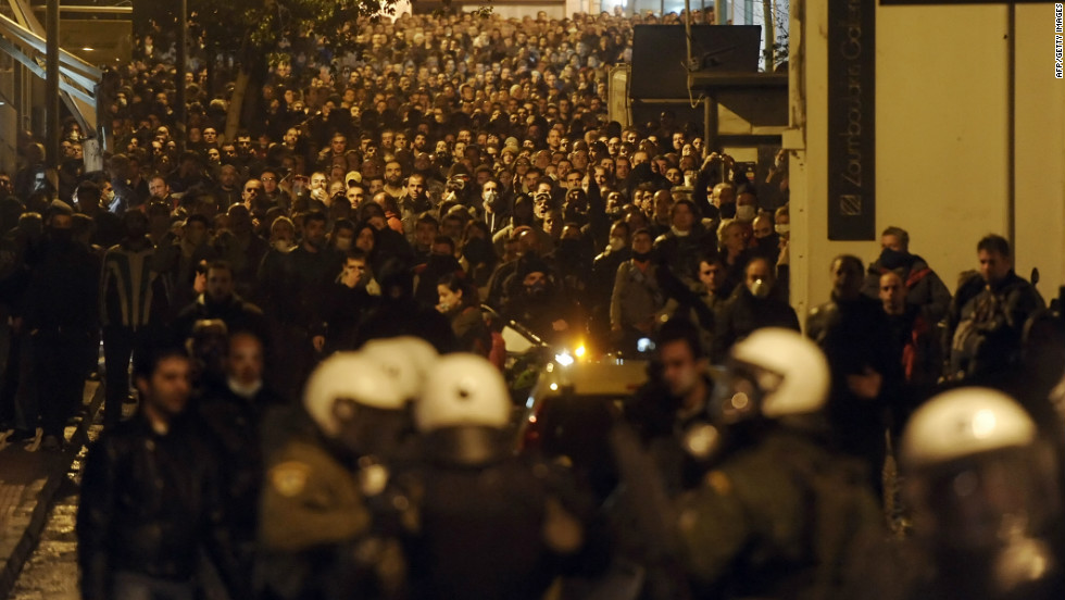 Protesters clash with riot police near the Greek parliament in Athens on February 12, 2012.