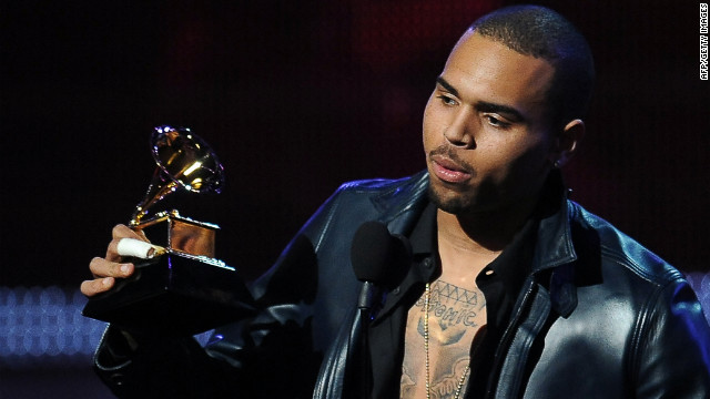 Chris Brown returned to the Grammys on Sunday, reigniting controversy about his domestic violence incident with Rihanna.