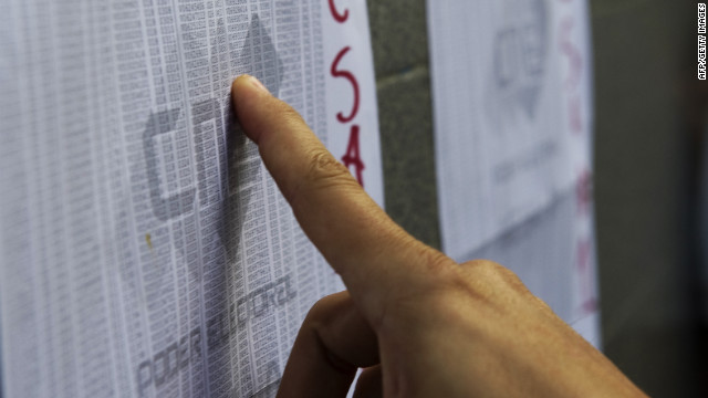 A voter checks the electoral roll at a polling station Sunday in Caracas, Venezuela.