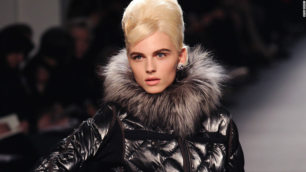 An androgynous look allows model Andrej Pejic to alternate between French designer Jean Paul Gaultier's men and women's fashions.