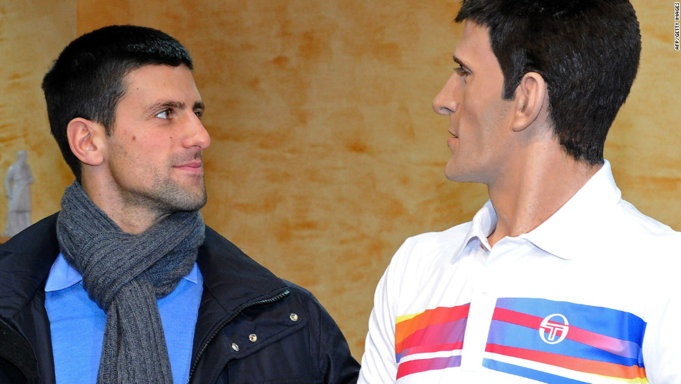 Sportsman of the year Novak Djokovic poses next to his likeness on February 9, 2012, at the wax museum in the central Serbian town of Jagodina.