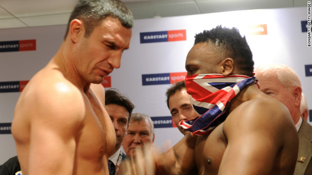 Derek Chisora slaps WBC heavyweight champion Vitali Klitschko at the weigh-in ahead of their fight