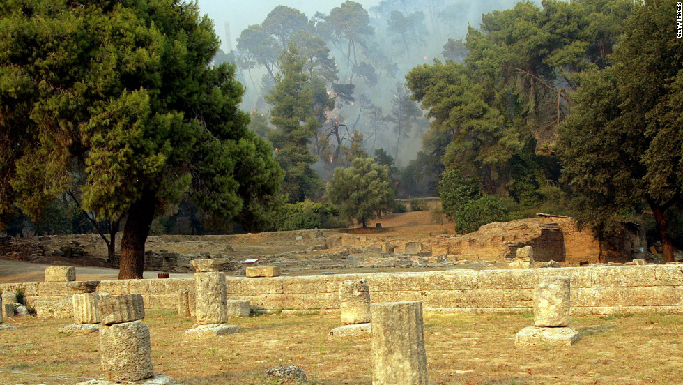 Ancient Olympia in Greece, pictured in 2007 during a spate of brush fires, is the site of the original Olympic Games.