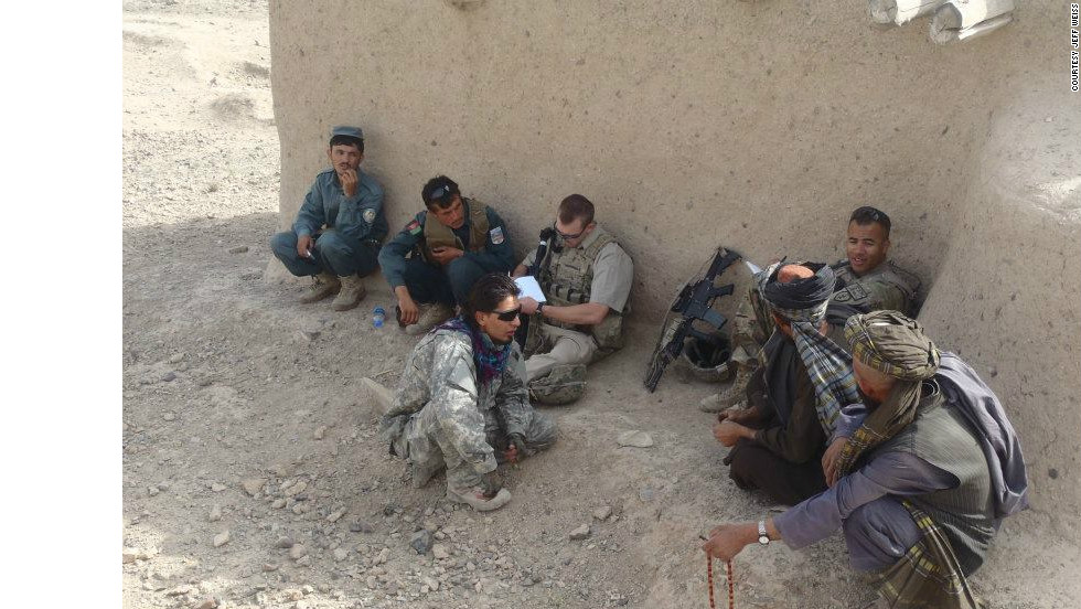 U.S. soldiers remind villagers in Shah Wali Kot, Afghanistan, about an upcoming shura, or council meeting.