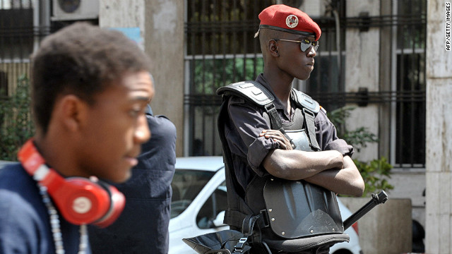 A Senegalese policeman stands guard in Dakar during a demonstration against President Abdoulaye Wade's bid for a third term.