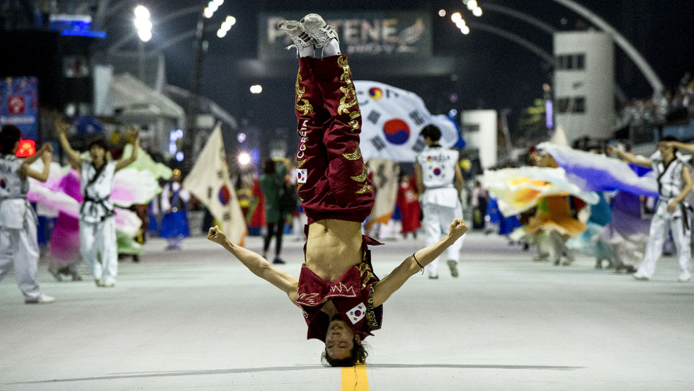 A South Korean hip-hop dancer performs in a parade in Sao Paulo on Friday to commemorate the 50th anniversary of South Korean immigration to Brazil.