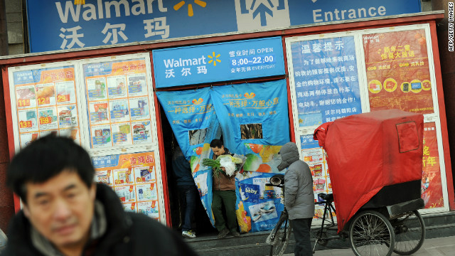Shoppers leave a Walmart store in Beijing, China, on January 3.