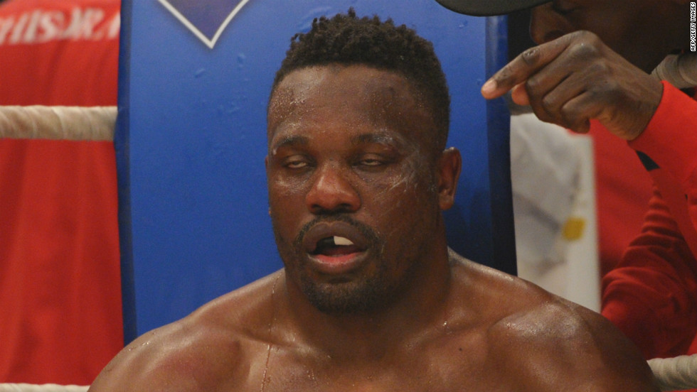 Chisora sits in his corner during his fight against WBC heavyweight champion Vitali Klitschko in the Olympic hall in Munich.