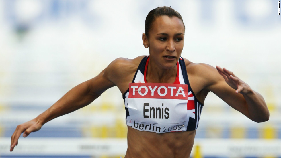 Ennis crosses the line in the 100-meter hurdles on the first day of her successful bid for the gold medal at the 2009 IAAF World Championships in Berlin.