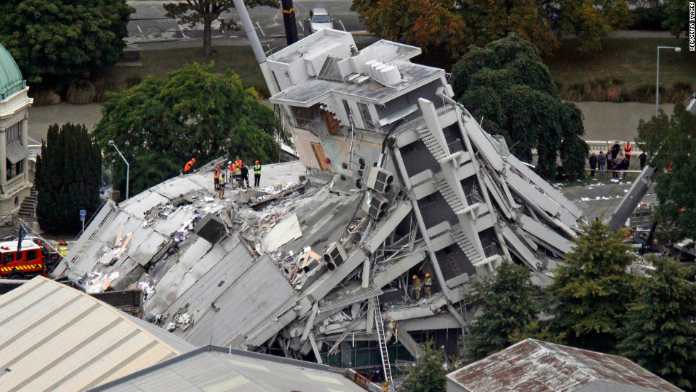 An image of the Pyne Gould Corporation building a day after the quake struck, as rescue workers look for survivors.
