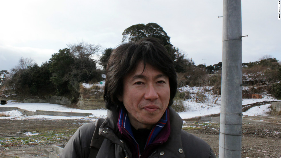 Standing in front of where his home used to be, Yoshimasa Koizumi says he has created a new form of cooperative he hopes will revive fishing and create a sustainable industry for the islanders.