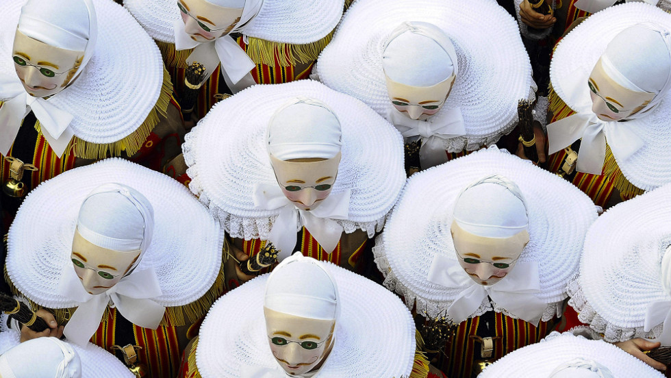People in traditional costumes parade during a carnival celebration in the streets of Binche, Belgium, on Tuesday.