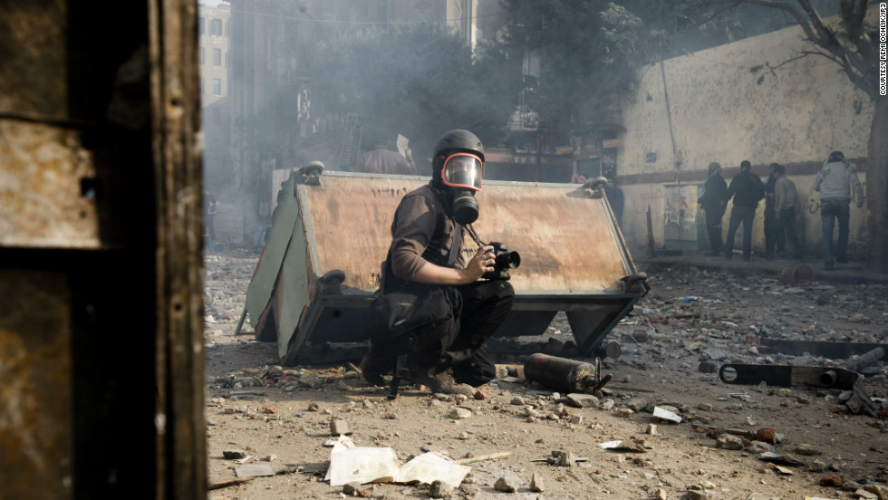 After undertaking his first overseas assignment in Haiti aged just 20, Ochlik had covered conflicts around the world. This image, taken by Julien de Rosa of EPA, shows him at work in Egypt.