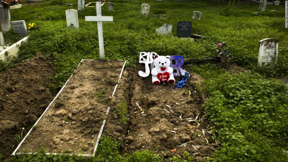 In January, 26 residents were slain in the Crescent City. Many of the poorest residents are buried in Holt Cemetery, where many signs are handwritten and graves may be dug by hand.