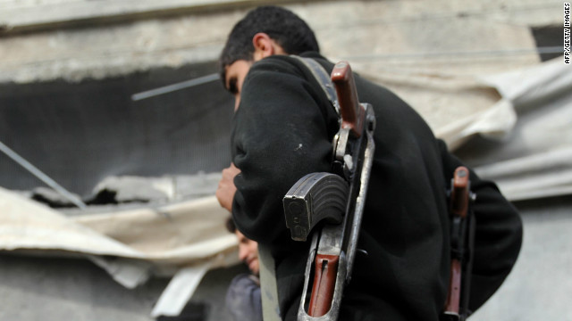 A  member of the Free Syrian Army takes position in Idlib in northwestern Syria on Wednesday.