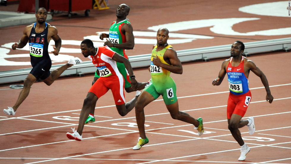 Prior to the Beijing Olympics, Gay was troubled by a hamstring injury which meant he arrived at the Games in less than perfect shape and he failed to win a medal. Here Gay (far left) finishes fifth in the 100m semifinal to miss out on the final, won by  Bolt in record time.