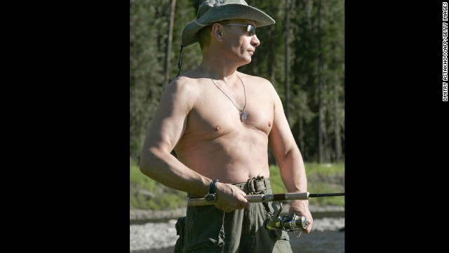 Picture taken 13 August 2007 shows Russian President Vladimir Putin fishing in the headwaters of the Yenisei River of the Russian Tuva republic on the border of Mongolia.