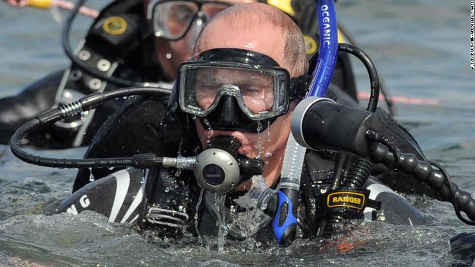 A wetsuit-clad Putin embarks on a dive to an underwater archaeological site at Phanagoria on the Taman Peninsula on August 10, 2011.