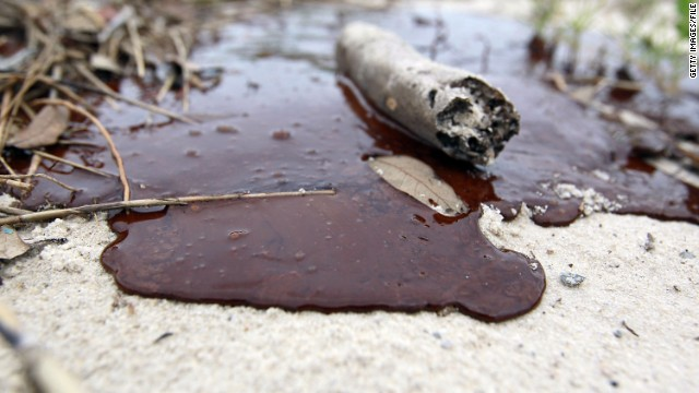 Thick oil is seen washed ashore from the Deepwater Horizon oil spill in the Gulf of Mexico on July 1, 2010 in Gulfport, Mississippi.