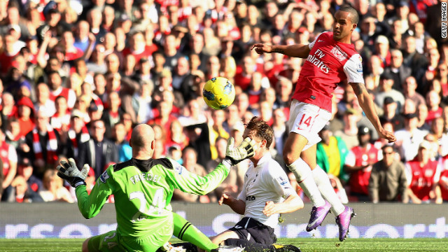 Theo Walcott scores the first of his two goals in Arsenal's 5-2 thrashing of Tottenham in the north London derby.