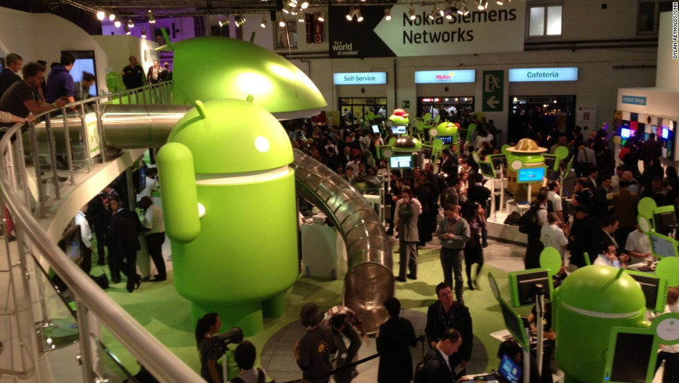 People wander through the Android display area. With no official Apple presence at the Mobile World Congress, Android phones dominate.