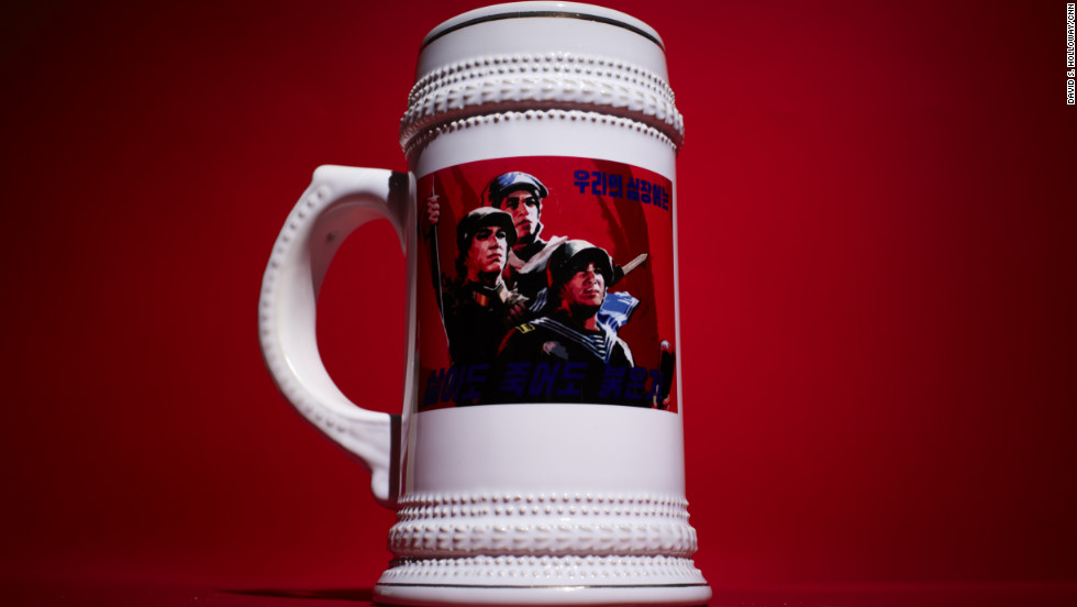 "This beer stein declares, ""In Life, In Death, Red Is In Our Hearts."""