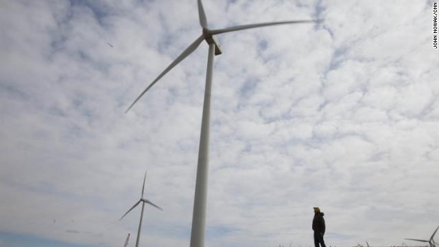 Dean Tofteland checks out a wind turbine in southwestern Minnesota.