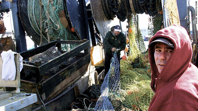 Fishermen work on docks in Gloucester, Massachusetts.