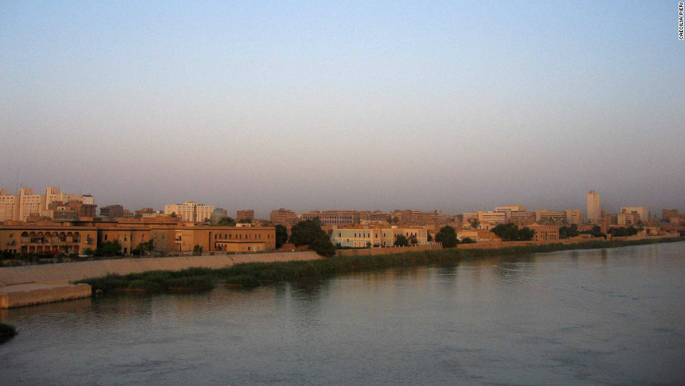 A waterfront panorama along the Tigris River, showing a low-rise city unlike many others in the Middle East.