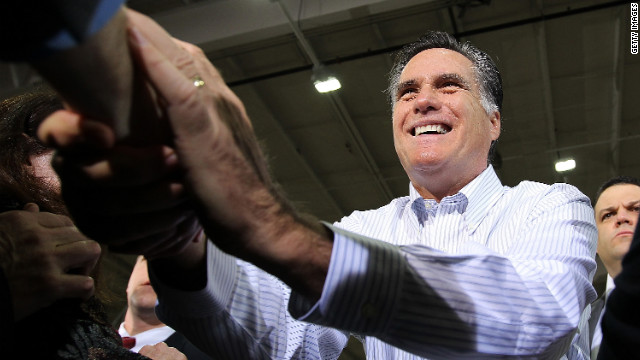 Mitt Romney greets supporters at a rally Monday in Rockford, Michigan. A win in the Michigan primary seems crucial for Romney.