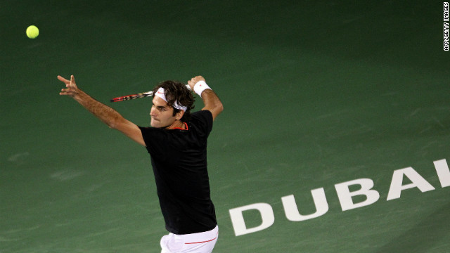 Roger Federer stayed on course for a fifth Dubai title with a first round victory over Michael Llodra