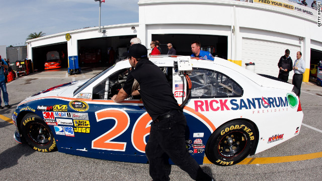 The #26 Ford, sponsored by Rick Santorum, is pushed Saturday during practice for the Daytona 500.