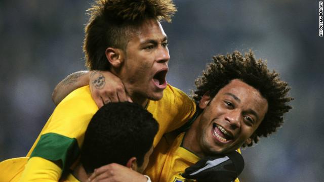 Real Madrid defender Marcelo (R) celebrates after scoring the opening goal for Brazil against Bosnia