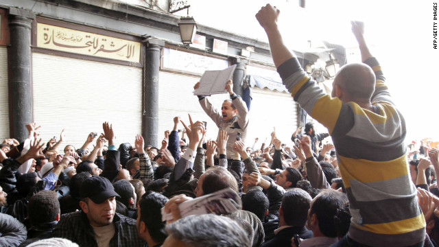 "Hundreds of Syrians march in Damascus in March 2011, chanting ""Daraa is Syria"" as protests spread throughout the country."