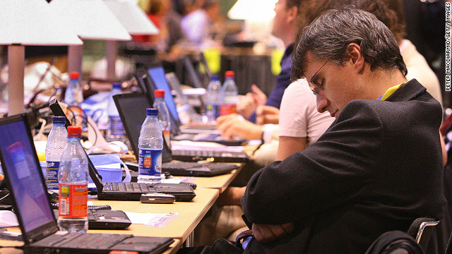 A man sleeps at a European Council meeting in Brussels, Belgium.