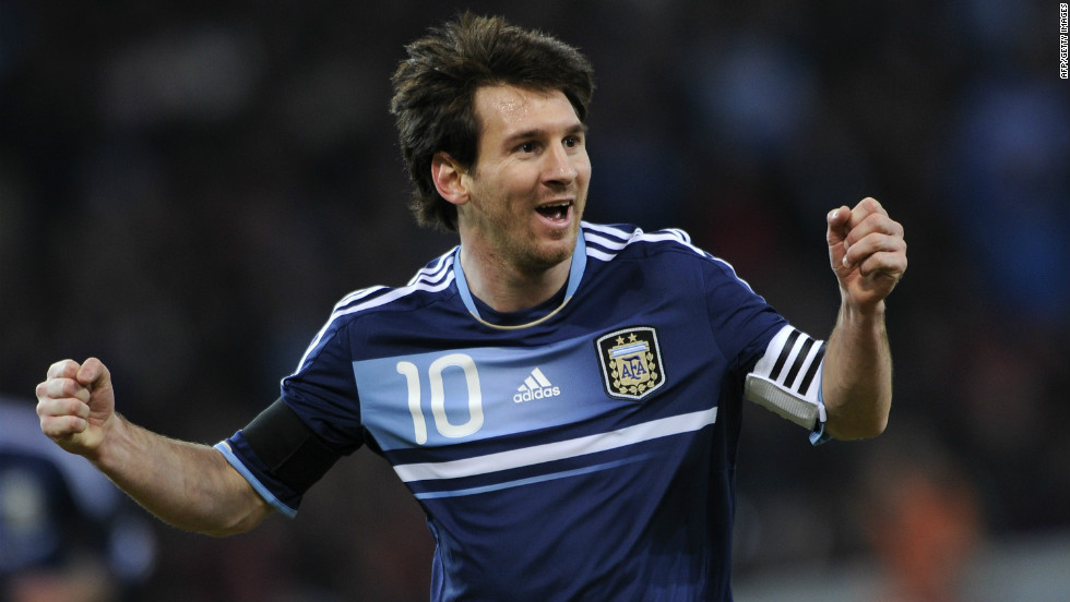 Barcelona ace Lionel Messi celebrates the opening goal of his hat-trick in Argentina's friendly win over Switzerland.