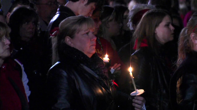 Town holds vigil after school shooting