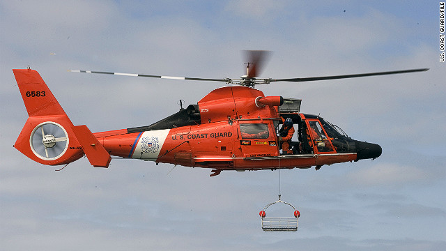 A Coast Guard MH-65 Dolphin is shown during training in May 2011.  An MH-65 crashed Tuesday night off the coast of Alabama.