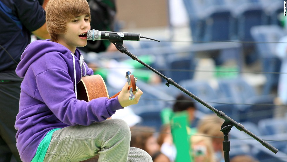The Stratford, Ontario, native first attracted attention on YouTube before the rest of the world noticed him. Here Bieber, in his signature purple hoodie, entertains crowds at Arthur Ashe Kids' Day, a U.S. Open event, in New York in August 2009.