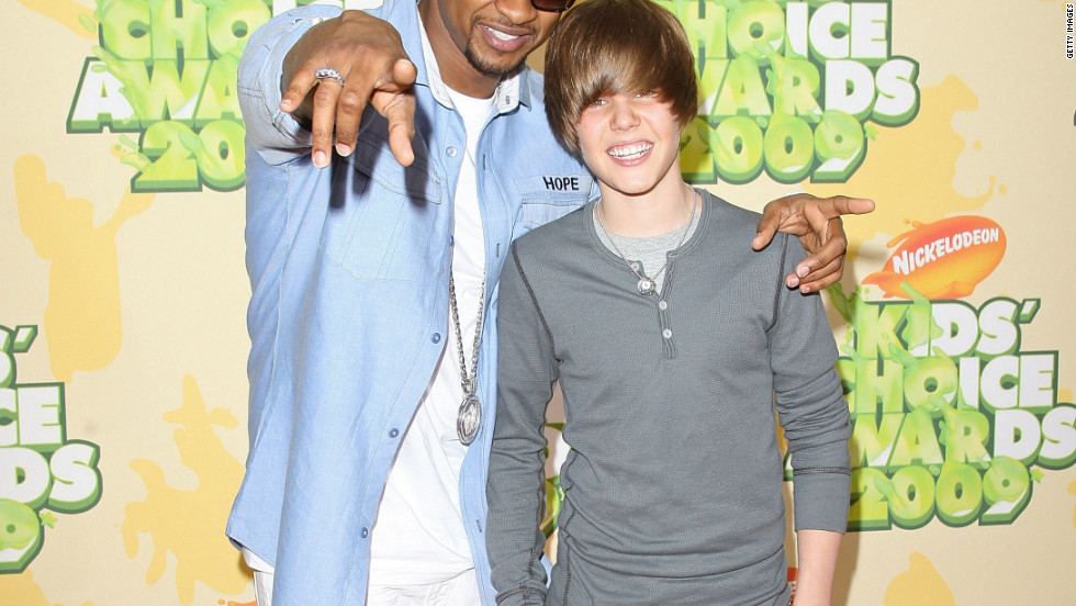 "At 15, Bieber had yet to become synonymous with the ubiquitous single ""Baby."" At this point, he was soaking up all he could learn from his mentor, Usher, whom he attended the Nickelodeon Kids' Choice Awards in March 2009."