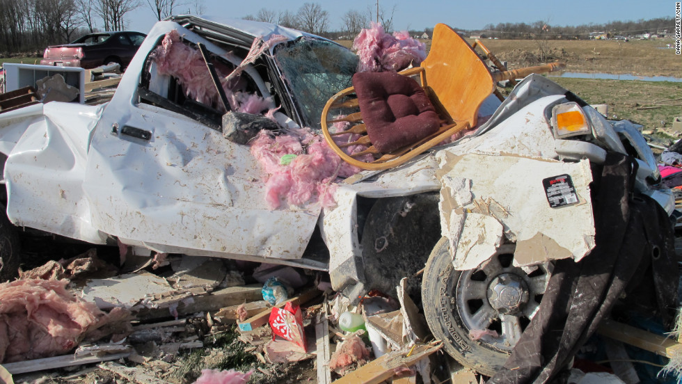 A truck appears twisted like a toy Thursday in the storm's aftermath in Harrisburg. A tornado with winds up to 180 mph thrashed the southern Illinois town early Wednesday.
