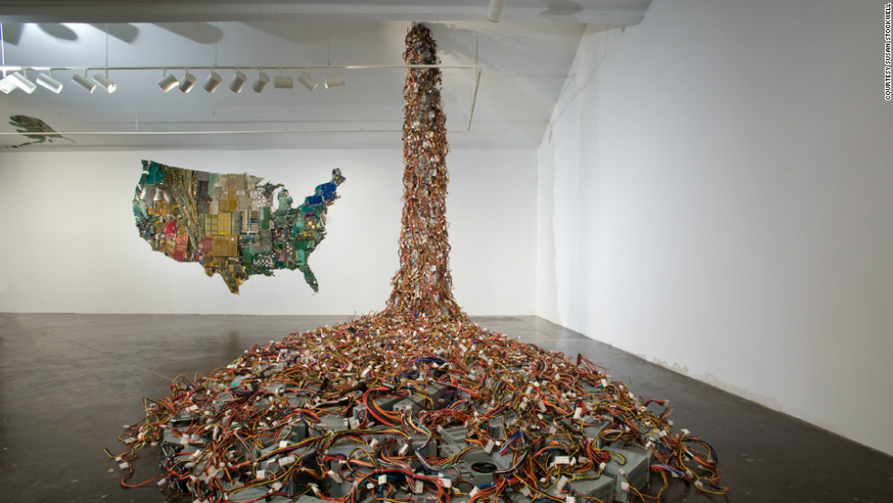 "Recycled computer motherboards and electrical parts have been transformed into an entire continent in <a href=""http://www.susanstockwell.co.uk/"" target=""_blank"">Susan Stockwell</a>'s remarkble map of America, while discarded monitors flood from the ceiling as part of this installation for the American Art League in Houston."