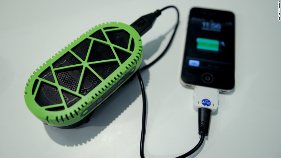 The FC PowerTrekk charger converts water into electricity to power a mobile.